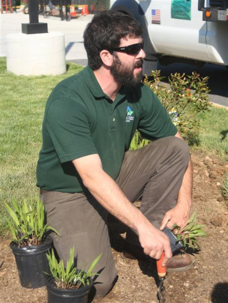 Mr. Dan of RainScapes Program shows how to dig right size hole for plants.