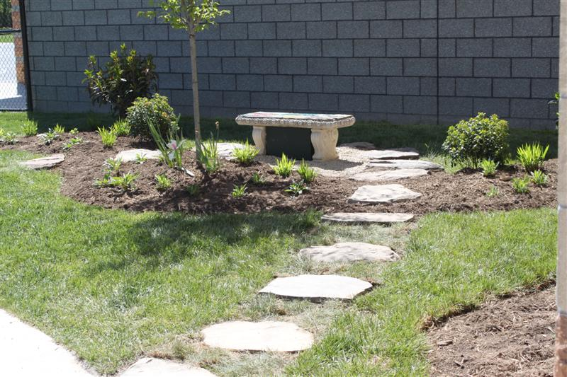 AFTER PHOTO - Another view of stone bench and pathway on left side of school.