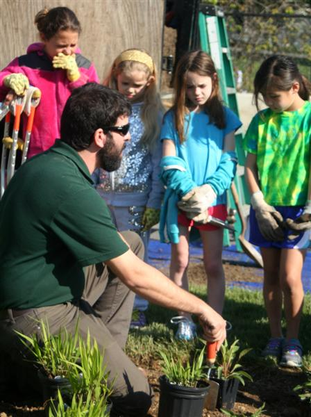 Mr. Dan telling students about native plants and how to install them.