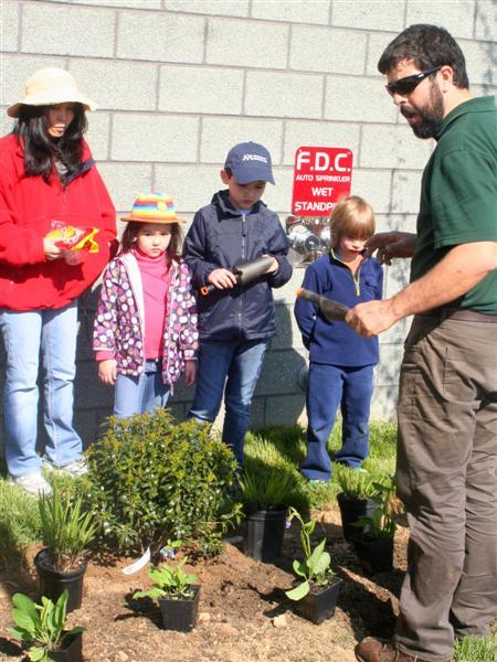Mr. Dan instructing new planters.